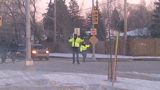 Cadets direct traffic at McPhillips Street and Kingsbury Avenue after a power outage on Sunday.